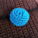 Teal button detail