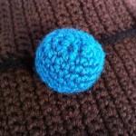 Teal button detail
